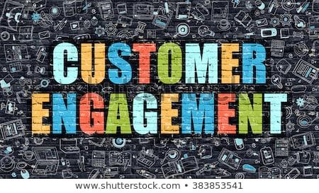 customer engagement concept multicolor on dark brickwall stock photo © tashatuvango