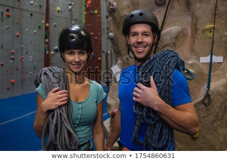 portrait of athletes in sports helmet carrying ropes at fitness studio stock photo © wavebreak_media