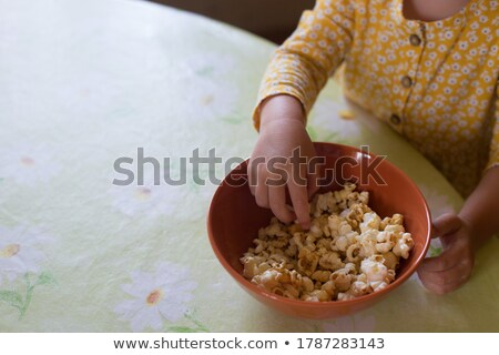 Toddler taking oranges from bowl Stock photo © IS2