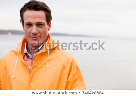 man in raincoat looking at viewer Stock photo © IS2