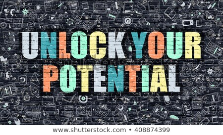 Multicolor Unlock Your Potential on Dark Brickwall. Doodle Style. Stock photo © tashatuvango