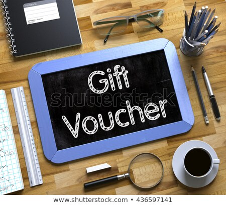 Small Chalkboard with Gift Voucher Concept. Stock photo © tashatuvango