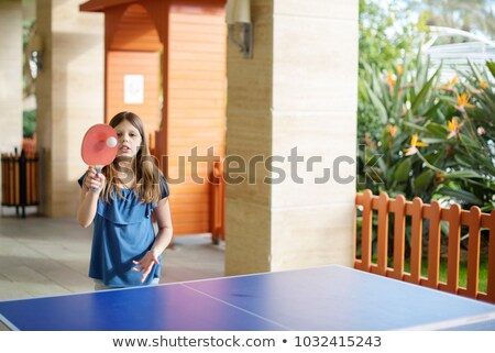 woman in a game of table tennis outdoors stock photo © is2