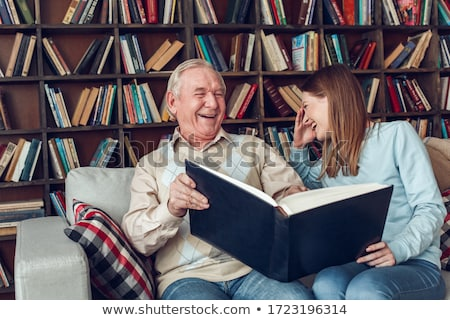 Woman and granddaughter by bookshelves Stock photo © IS2