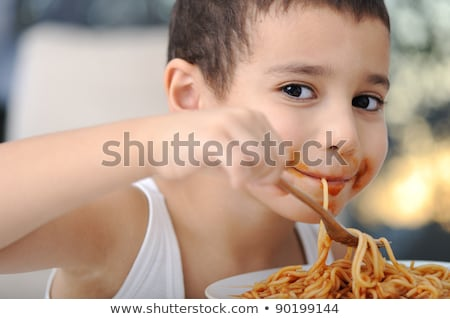 Boy holding plates and cutlery Stock photo © IS2