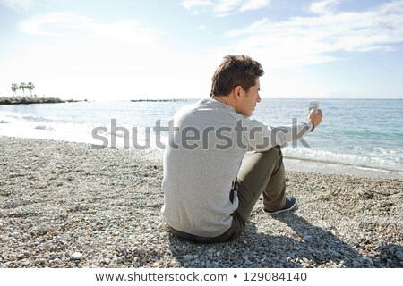 Sitting down on a pebble beach Stock photo © IS2