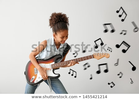Stock photo: Girl playing electric guitar