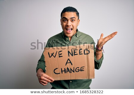 A man protests with a poster. Isolate on white background Stock photo © studiostoks