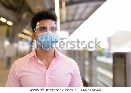 Businessman at the sky train station in Bangkok, Thailand Stock photo © amazingmikael