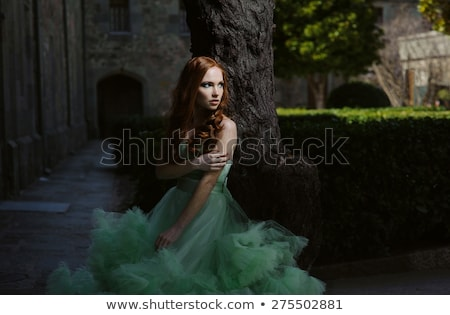 Beautiful red-haired girl at grass Stock photo © Massonforstock