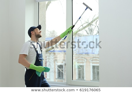 Man washing the window glass with cloth Stock photo © Kzenon