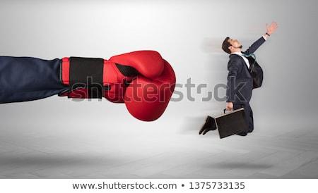 Gigante mão chutá pequeno empresário empregado Foto stock © ra2studio