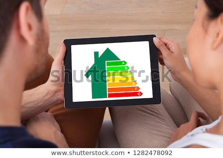 Couple Holding Digital Tablet With Energy Efficiency Chart Stock photo © AndreyPopov
