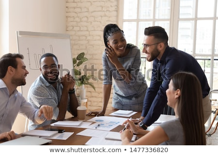 joyful multiracial business team at work in modern office stock photo © boggy