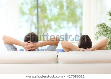 Young couple by the window stock photo © boggy