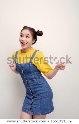 Retrato excitado niña feliz dos senalando dedos Foto stock © deandrobot