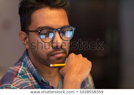 Közelkép kreatív férfi dolgozik éjszaka iroda Stock fotó © dolgachov