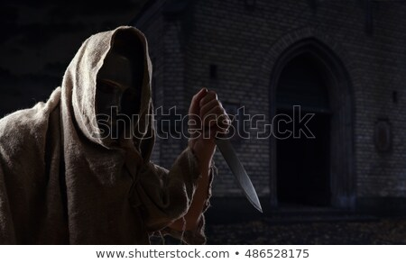 man hand with knife in the cemetery of Halloween night Stock photo © adrenalina