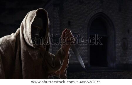 Hombre mano cuchillo cementerio halloween noche Foto stock © adrenalina