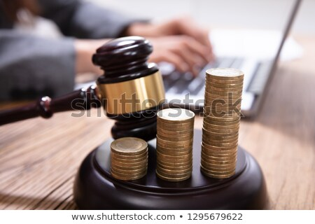 Stack Of Increasing Coins On Gavel At Workplace Stock photo © AndreyPopov