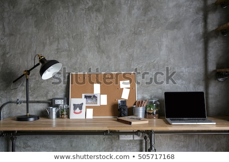Stock photo: Loft home office workplace with supplies and camera
