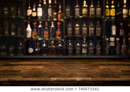 bar counter with bottles in blurred background stock photo © dashapetrenko