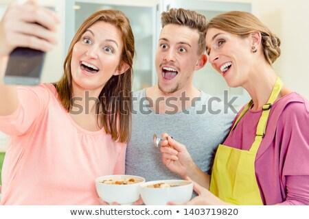 Pár tart tál házi készítésű kása mosolyog Stock fotó © Kzenon