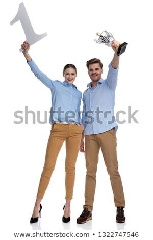 Férfi ünnepel szám kezek levegő ülő Stock fotó © feedough