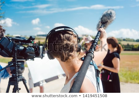 A man holding boom microphone Stock photo © colematt