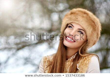 счастливым женщину зима мех Hat Сток-фото © dolgachov