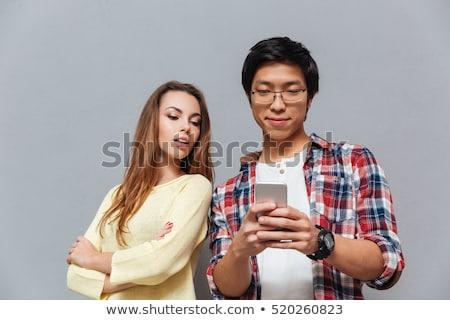 jaloers · vrouw · naar · partner · telefoon - stockfoto © deandrobot