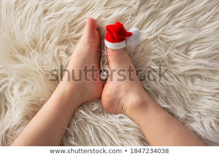 Feet in furry heels. Stock photo © iofoto