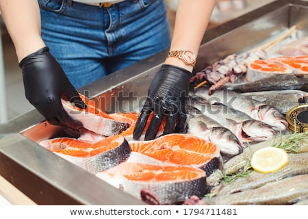 close up of chilled oysters on ice at fish market Stock photo © dolgachov