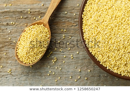 Heap of millet groats on white wooden background Stock photo © Melnyk