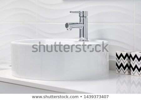 Close up of new clean white round shaped ceramic sink and faucet Stock photo © amok