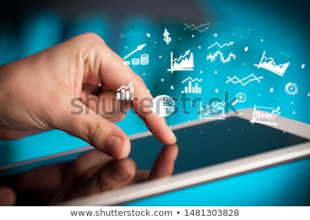 Hand holding tablet with virtual database concept Stock photo © ra2studio