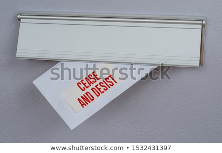 A letter in a mail slot - Cease and Desist Stock photo © Zerbor