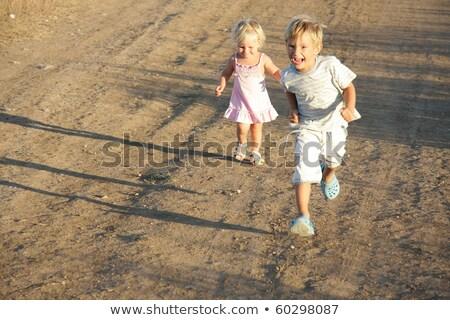 gyerek · fut · vidék · derűs · imádnivaló · szőke · nő - stock fotó © konradbak