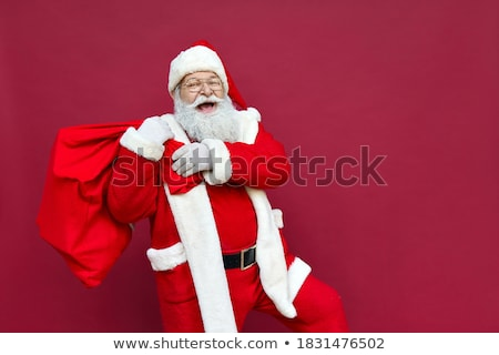 Christmas online sales concept. Santa Claus comes out of the smartphone Stock photo © studiostoks