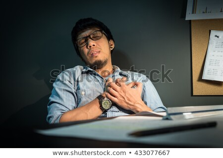 Man Wearing Blue Shirt Suffering From Heart Attack Stock photo © AndreyPopov