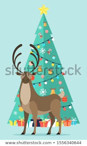 Reindeer near Decorated Fir Tree with Garlands Stock photo © robuart