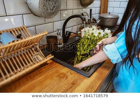 Crop woman cutting flowers in sink Stock photo © dashapetrenko