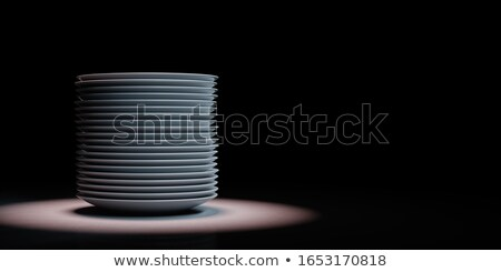 Heap of White Porcelain Dishes Spotlighted on Black Background Stock photo © make