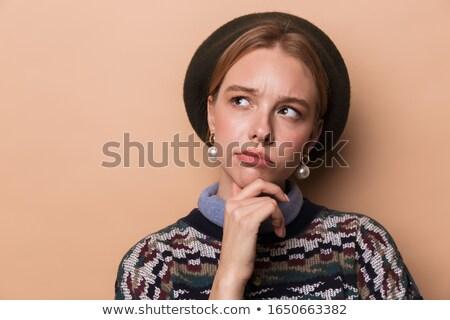 Photo of seductive thinking woman posing and looking upward Stock photo © deandrobot