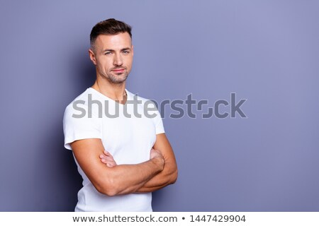 Joyful smiling handsome masculine man in t-shirt, cross arms chest confident, laughing as having car Stock photo © benzoix