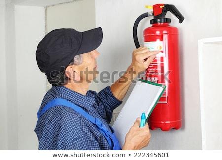 Profi tűzoltó készülék férfi állapot tűz férfi Stock fotó © AndreyPopov