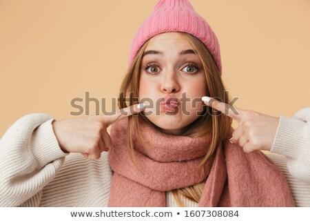 Kép lány tél kalap tart lélegzet Stock fotó © deandrobot