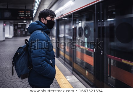 Woman tourist in medical mask in Seoul, South Korea. Travel to Korea concept Tourists fear the 2019- Stock photo © galitskaya