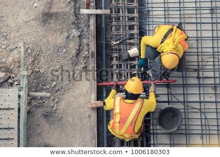 建設 小さな 着用 ヘルメット 立って 建物 ストックフォト © pkdinkar
