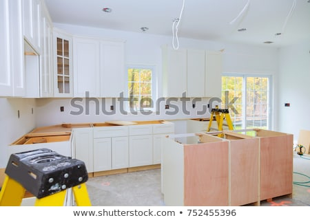 Workers renovating a kitchen Stock photo © photography33